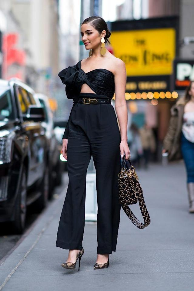 <p>The Rhode Island native seems unbothered by New York's winter weather in a one-sleeved jumpsuit. (Photo: Getty Images) </p>