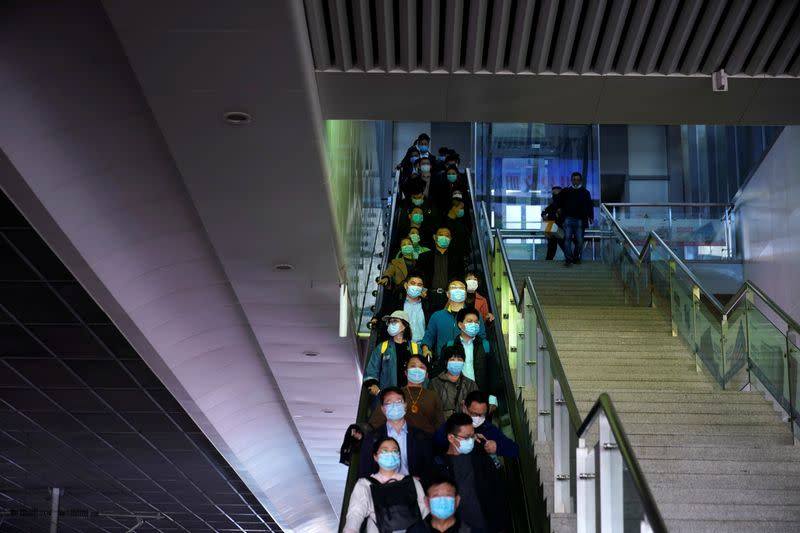 People wearing face masks amid the global outbreak of the coronavirus disease (COVID-19) are seen at Shanghai Hongqiao Railway Station in Shanghai