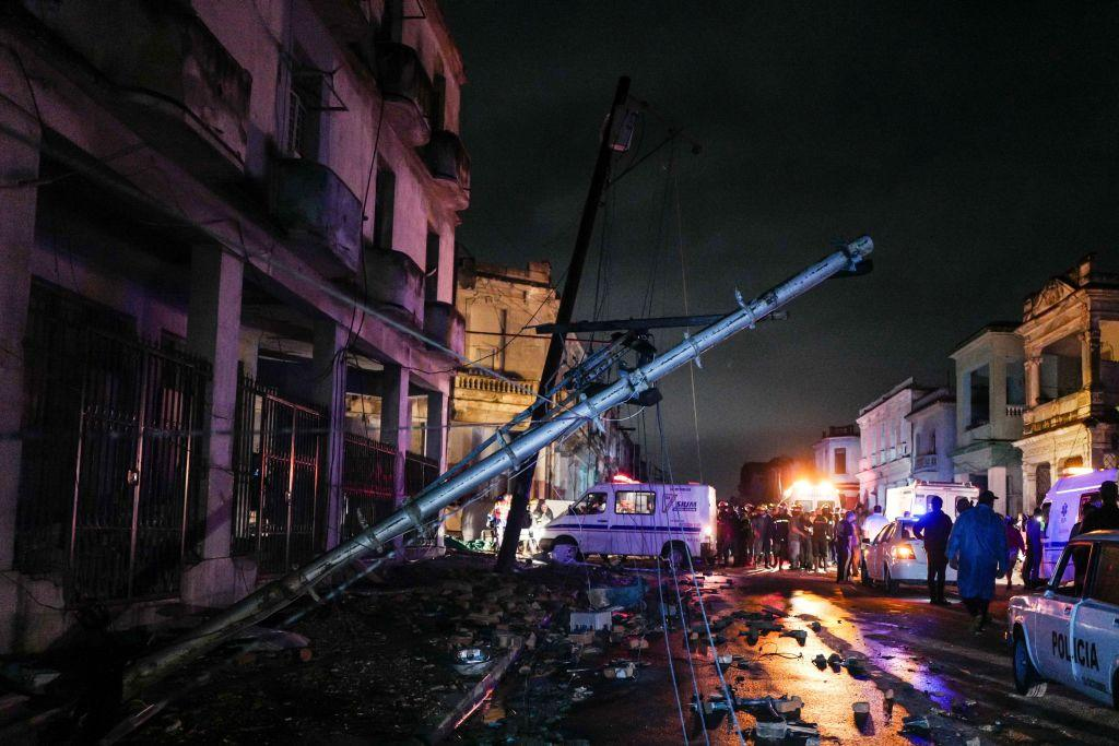 <p>A fallen utility pole is seen among debris in the tornado-hit Luyano neighbourhood in Havana early on Jan. 28, 2019. A tornado hit several neighborhoods in Havana overnight on Jan. 28, disrupting electrical power and damaging buildings and cars. Cuba's President Miguel Díaz-Canel says at least three people are dead and 174 have been injured. (Photo from Adalberto Roque/AFP/Getty Images) </p>
