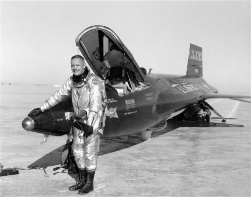 Neil Armstrong poses with an X-15 aircraft at the Dryden Flight Research Center in California, in this undated handout photo courtesy of NASA.