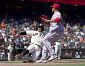 San Francisco Giants' Donovan Solano, left, slides into home plate on a wild pitch by Los Angeles Angels' Jose Quijada, right, during the seventh inning of a baseball game Monday, May 31, 2021, in San Francisco. (AP Photo/Tony Avelar)