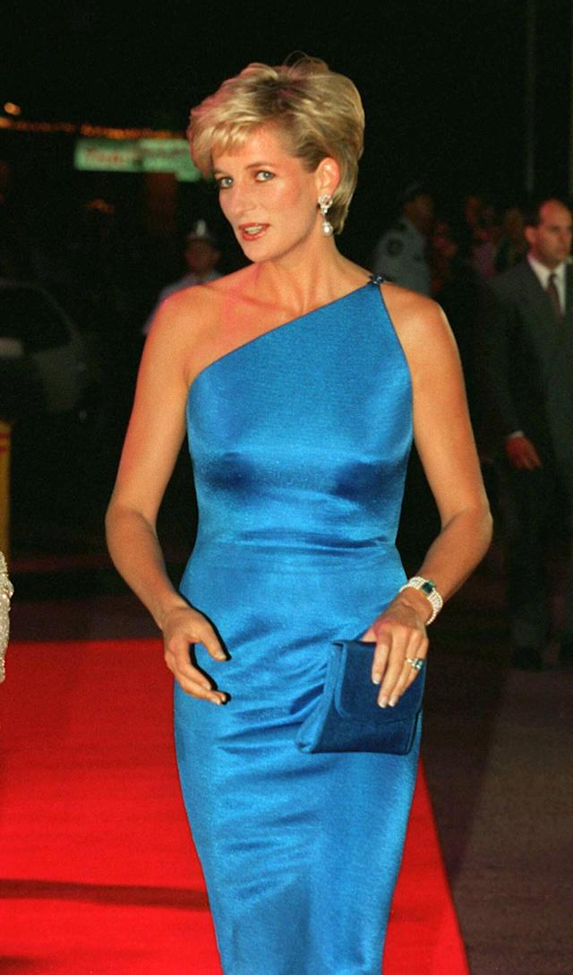 <p>Back in October 1996, Princess Diana attended a benefit dinner in Australia in a one-shouldered Versace dress. She accessorised her look with a five-strand pearl bracelet adorned with an aquamarine jewel. The princess also donned an emerald ring that she had commissioned by Asprey in 1997. (Photo: PA) </p>