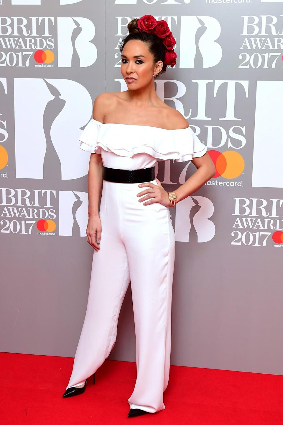 <p>Myleene added a flamenco touch to her ruffled white jumpsuit. <i>[Photo: PA]</i> </p>