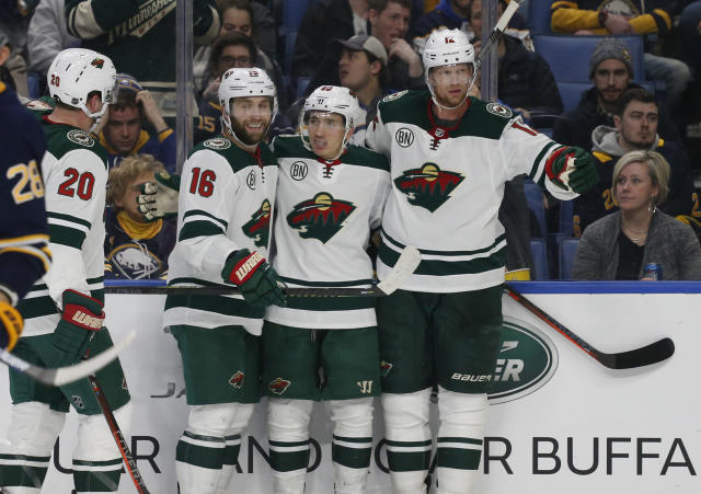 Minnesota Wild players from left, Ryan Suter, Jason Zucker, Jared Spurgeon, and Eris Staal, celebrate a goal during the second period of an NHL hockey game against the Buffalo Sabres, Tuesday, Feb. 5, 2019, in Buffalo N.Y. (AP Photo/Jeffrey T. Barnes)