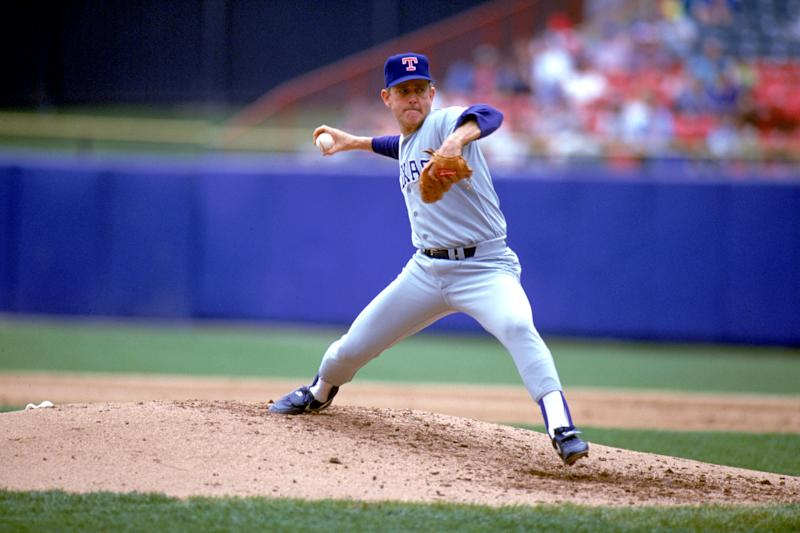 UNDATED: Pitcher Nolan Ryan #34 of the Texas Rangers delivers a pitch during a game circa 1989-1993. (Photo by Ron Vesely/MLB Photos via Getty Images)