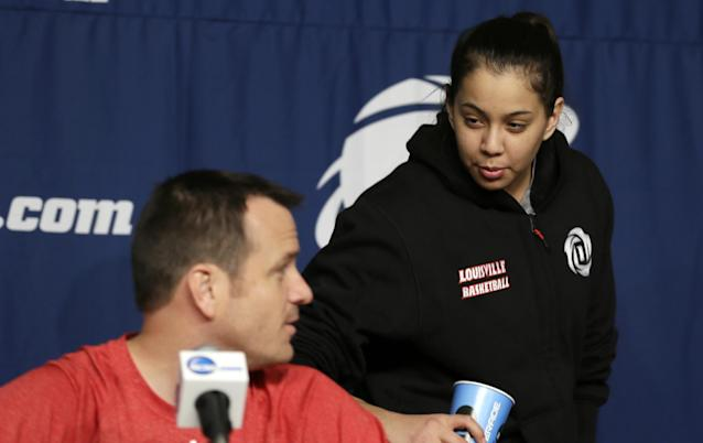 Louisville guard Shoni Schimmel, right, talks with head coach Jeff Walz during a news conference before practice at the NCAA women's college basketball tournament, Saturday, March 22, 2014, in Iowa City, Iowa. Louisville plays Idaho in a first-round game on Sunday. (AP Photo/Charlie Neibergall)