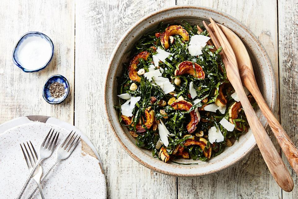 "The orange-colored squash and sweet golden raisins are a beautiful contrast to the dark, earthy kale and roasted garlic dressing. We like to think of this salad as fall in a bowl. <a href=""https://www.epicurious.com/recipes/food/views/autumn-kale-salad-gefilte-manifesto-recipe?mbid=synd_yahoo_rss"" rel=""nofollow noopener"" target=""_blank"" data-ylk=""slk:See recipe."" class=""link rapid-noclick-resp"">See recipe.</a>"