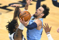 Memphis Grizzlies forward Dillon Brooks, right, goes to the basket as Utah Jazz center Derrick Favors defends during the first half of Game 3 of an NBA basketball first-round playoff series Saturday, May 29, 2021, in Memphis, Tenn. (AP Photo/John Amis)