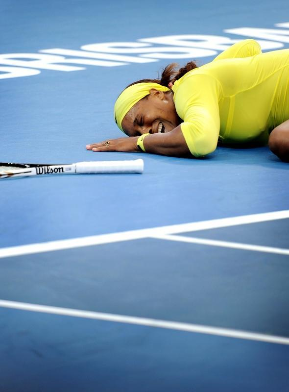 Serena Williams of the US cries out after injuring her ankle during her second round women's singles match against Bojana Jovanovski of Serbia at the Brisbane International tennis tournament in Brisbane on January 4, 2012. IMAGE STRICTLY RESTRICTED TO EDITORIAL USE - STRICTLY NO COMMERCIAL USE. TOPSHOTS AFP PHOTO / William WEST