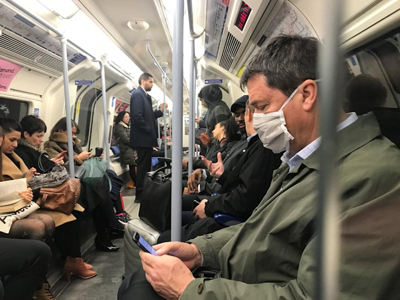 A man on the Jubilee line of the London Underground tube network wearing a protective facemask on the day that Heath Secretary Matt Hancock said that the number of people diagnosed with coronavirus in the UK has risen to 51. PA Photo. Picture date: Tuesday March 3, 2020. See PA story HEALTH Coronavirus. Photo credit should read: Kirsty O'Connor/ PA Wire