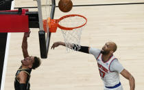 Atlanta Hawks' Trae Young (11) shoots and scores against New York Knicks' Taj Gibson (67) during the first half in Game 4 of an NBA basketball first-round playoff series Sunday, May 30, 2021, in Atlanta. (AP Photo/Brynn Anderson)