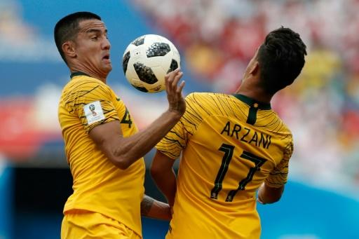 Tim Cahill with youngster Daniel Arzani - the veteran finally saw action at this World Cup but could not prevent Australia from going down 2-0 to Peru