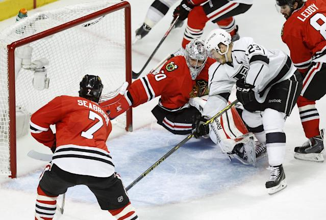Los Angeles Kings right wing Dustin Brown (23) shoot a goal against Chicago Blackhawks goalie Corey Crawford (50) during the second period in Game 5 of the Western Conference finals in the NHL hockey Stanley Cup playoffs Wednesday, May 28, 2014, in Chicago. (AP Photo/Andrew A. Nelles)