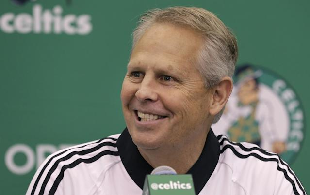Celtics general manager Danny Ainge smiles like a man who knows he's got the Nets on call waiting. (AP)