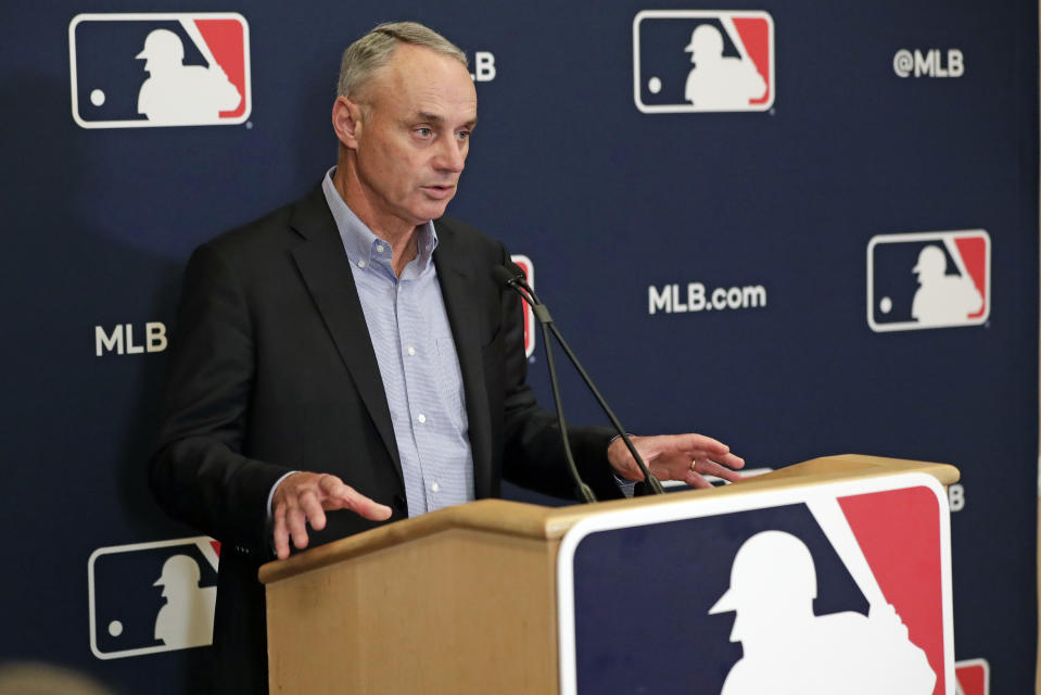 MLB Commissioner Rob Manfred answers questions at a press conference during MLB baseball owners meetings, Thursday, Feb. 6, 2020, in Orlando, Fla. (AP Photo/John Raoux)