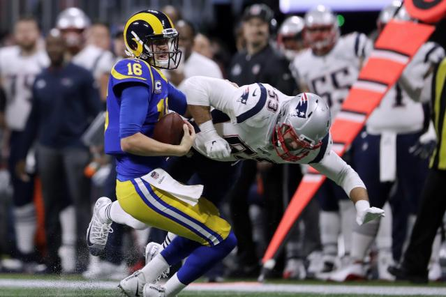 <p>Los Angeles Rams' Jared Goff (16) gets sacked by New England Patriots' Kyle Van Noy (53) during the first half of the NFL Super Bowl 53 football game Sunday, Feb. 3, 2019, in Atlanta. (AP Photo/John Bazemore) </p>