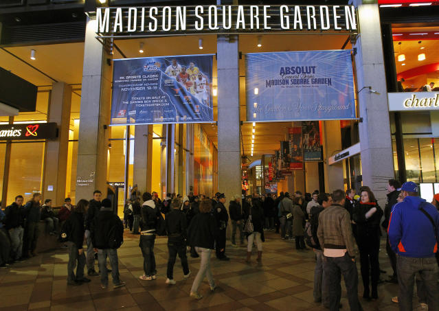 Fans stand outside am entrance to Madison Square Garden as they were turned away because the game between the New York Knicks and the Orlando Magic was postponed, Tuesday, Nov. 2, 2010, in New York. The game was postponed because of safety concerns after debris fell into the arena during overnight cleaning of asbestos-related materials. A spokesman for New York City's Department of Environmental Protection, Farrell Sklerov, said the agency's inspectors were on the scene and had determined that no asbestos had been released. (AP Photo/Paul J. Bereswill)