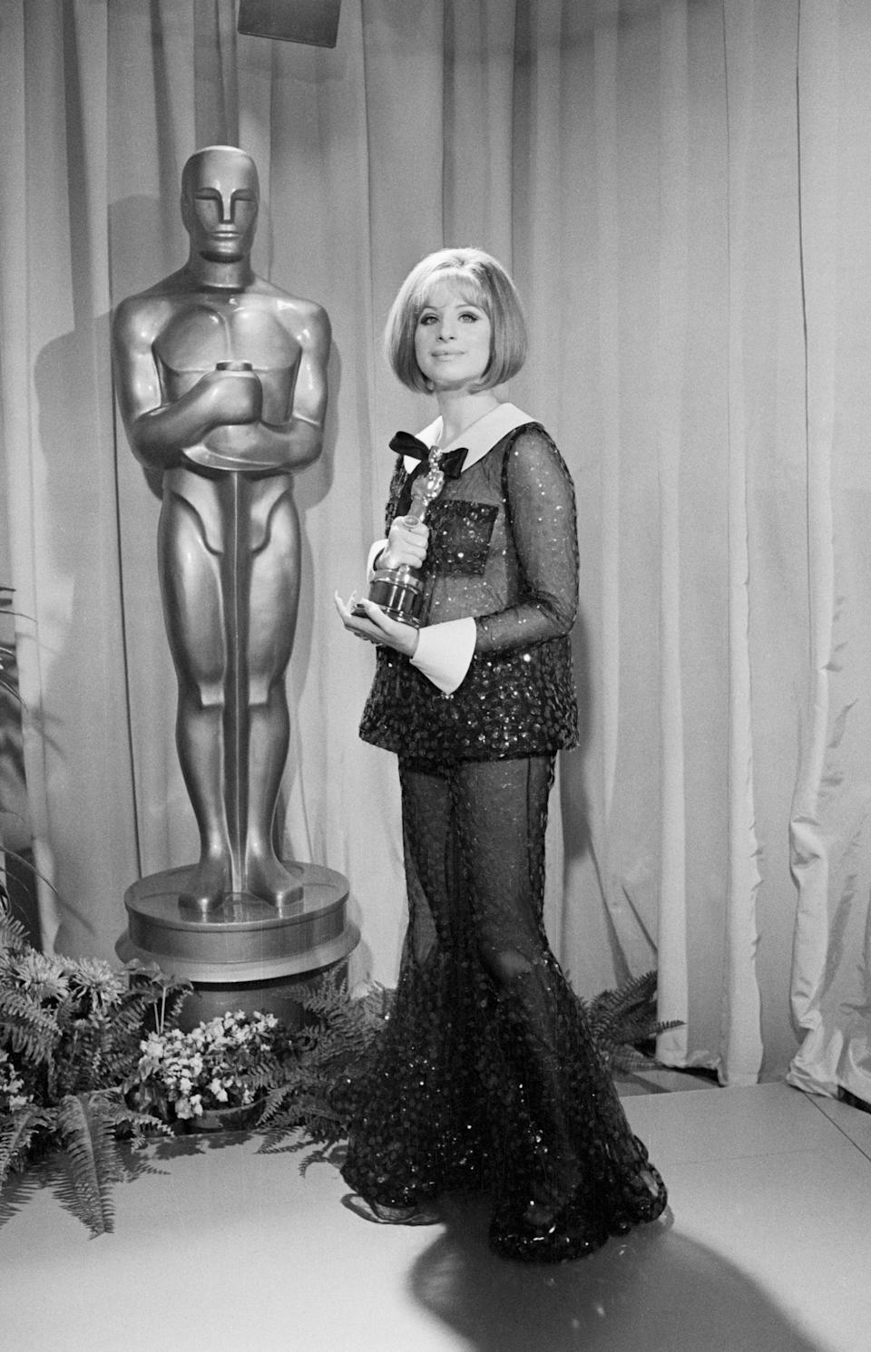 <p>Barbra Streisand took a daring leap with this sheer Arnold Scaasi dress, and we're sure happy she did! </p>