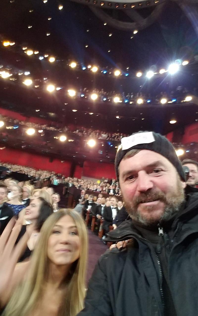 Pete Hobden pictured with Jennifer Aniston and the audience at the Oscars - Credit: SWNS
