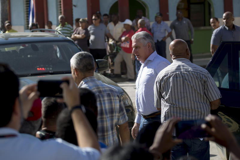 Cuba's President Miguel Diaz-Canel arrives in Caimanera, Cuba, Thursday, Nov. 14, 2019.  Díaz-Canel is making his first trip to the town of Caimanera, the closest point in Cuba to the U.S. naval base at Guantanamo Bay. He arrived on Thursday morning. ( AP Photo/Ismael Francisco)