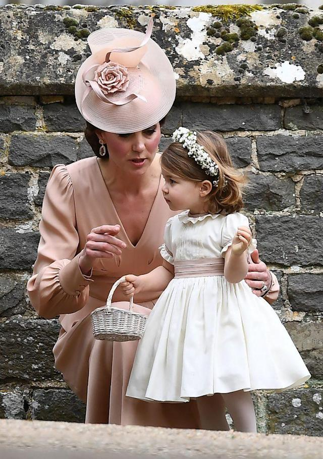 Kate looked after 2-year-old Charlotte throughout the ceremony. (Photo: PA)