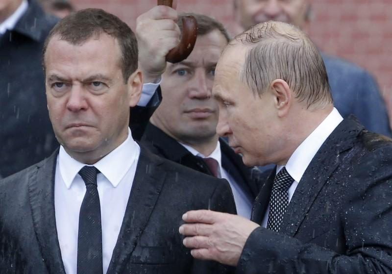 FILE PHOTO: Russian President Putin and Prime Minister Medvedev attend a wreath-laying ceremony marking the anniversary of the Nazi German invasion in Moscow