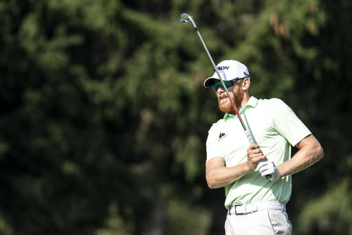Sebastian Soderberg of Sweden watches his approach shot during the second round of the European Masters golf tournament in Crans-Montana, Switzerland, Friday, Aug. 30, 2019. (Alexandra Wey/Keystone via AP)