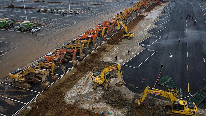 Construction continues at a field hospital in Wuhan, Hubei province, China. Wuhan Leishenshan hospital will be completed on February 5, with a capacity of 1300 beds. Source: Getty