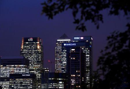 FILE PHOTO: Office blocks of Citi, Barclays, and HSBC banks are seen at dusk in the Canary Wharf financial district in London, Britain November 16, 2017. REUTERS/Toby Melville/File Photo