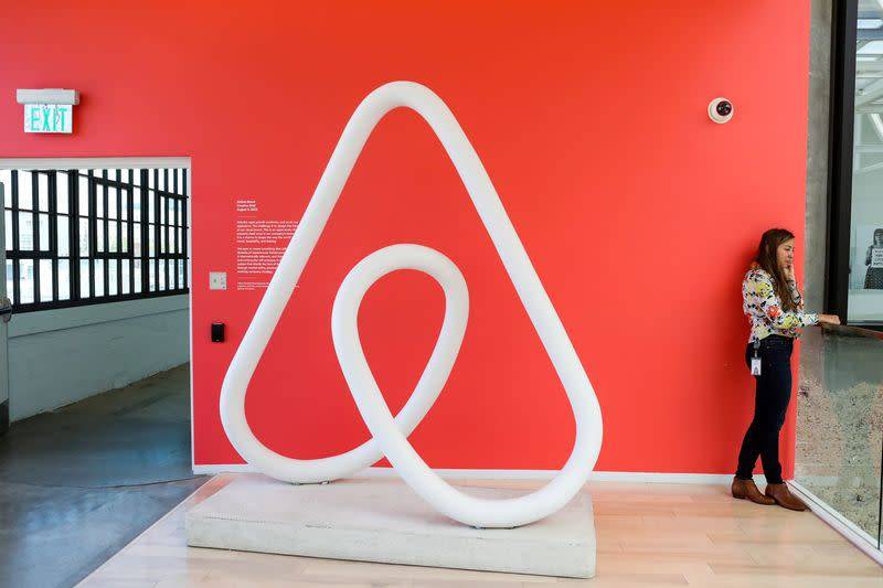 FILE PHOTO: A woman talks on the phone at the Airbnb office headquarters in the SOMA district of San Francisco