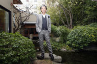 FILE - In this Tuesday, March 24, 2009 file photo, Japanese fashion designer Kenzo Takada poses outside his Paris house. Fashion designer Kenzo Takada dies from COVID-19 complications at age 81 near Paris, spokeswoman and reports said Sunday Oct. 4, 2020. (AP Photo/Jacques Brinon, file)