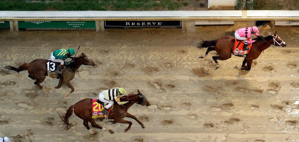 Luis Saez rides Maximum Security across the finish line first followed by Flavien Prat on Country House during the 145th running of the Kentucky Derby horse race at Churchill Downs Saturday, May 4, 2019, in Louisville, Ky. Country House was declared the winner after Maximum Security was disqualified following a review by race stewards. (AP)