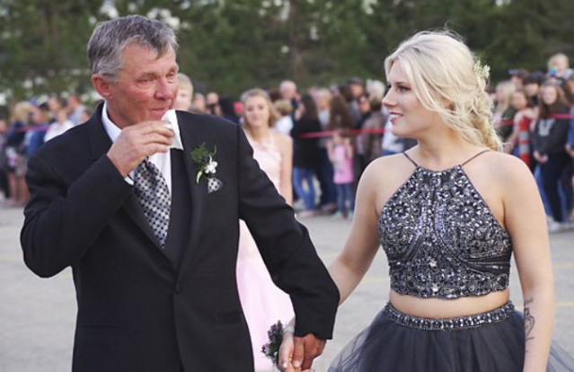 <span>Carson Curtis,</span>the father of 18-year-old Marshall Curtis who died in a car accident in May, stepped up to take his son's girlfriend,Mackenzie <span>Stewart,</span> to the prom. (Photo: Courtesy of Elizabeth Curtis)
