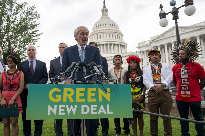Sen. Ed Markey, D-Mass., chairman of the Senate Climate Change Task Force, joined at left by Sen. Chris Van Hollen, D-Md., Sen. Jeff Merkley, D-Ore., and indigenous people of the Americas, at a news conference at the Capitol in Washington, Tuesday, Sept. 17, 2019. (AP Photo/J. Scott Applewhite)