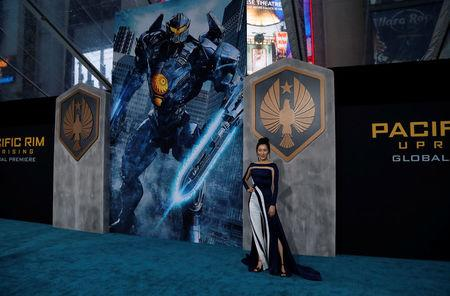 """Cast member Ji poses at the premiere for """"Pacific Rim: Uprising"""" in Los Angeles"""