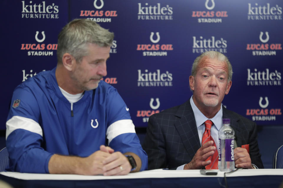 Indianapolis Colts coach Frank Reich listens as team owner Jim Irsay speaks