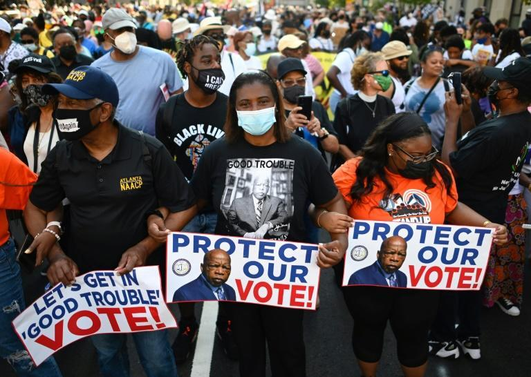 Some states, mainly in the south, have passed often technical changes that make it harder for African Americans, who tend to be Democrat voters, to cast a ballot (AFP/ANDREW CABALLERO-REYNOLDS)