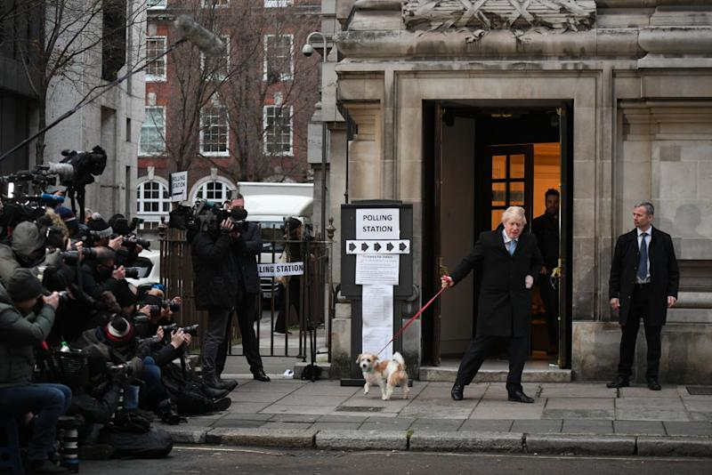 Prime Minister Boris Johnson leaves after casting his vote with dog Dilyn at Methodist Hall polling station on December 12, 2019 in London, England. Source: Getty