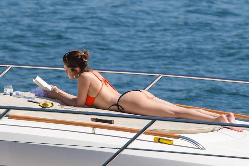 Relaxing: Selena Gomez catches up on her reading (Splash News)