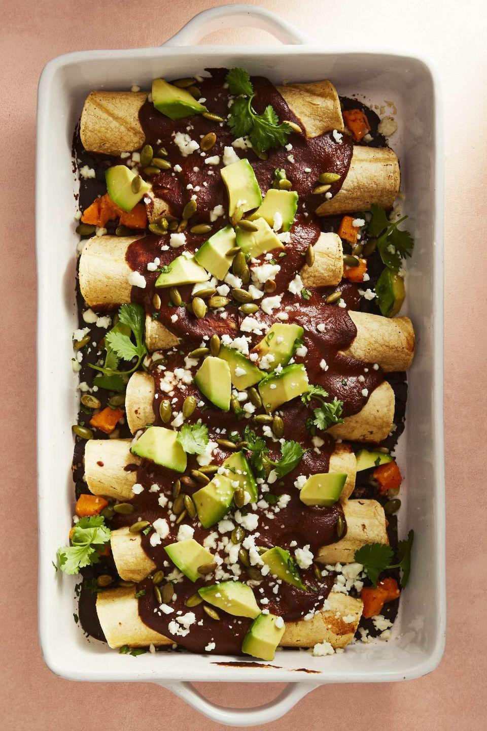 """<p>Get your fiesta on faster with these make-ahead enchiladas. The tortillas can be filled, wrapped, and frozen up to two months without the sauce. Or, you can keep the whole casserole assembled in the fridge for up to a day before baking.</p><p><em><a href=""""https://www.goodhousekeeping.com/food-recipes/healthy/a47527/butternut-mole-enchiladas-recipe/"""" rel=""""nofollow noopener"""" target=""""_blank"""" data-ylk=""""slk:Get the recipe for Butternut Mole Enchiladas »"""" class=""""link rapid-noclick-resp"""">Get the recipe for Butternut Mole Enchiladas » </a></em></p><p><strong>RELATED: </strong><a href=""""https://www.goodhousekeeping.com/food-recipes/easy/g4254/enchiladas/"""" rel=""""nofollow noopener"""" target=""""_blank"""" data-ylk=""""slk:30+ Easy Enchilada Recipes Your Dinner Rotation Has Been Missing"""" class=""""link rapid-noclick-resp"""">30+ Easy Enchilada Recipes Your Dinner Rotation Has Been Missing</a></p>"""