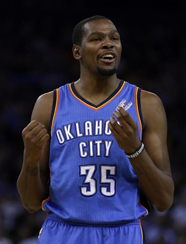 Oklahoma City Thunder's Kevin Durant reacts after scoring against the Golden State Warriors during the first half of an NBA basketball game Thursday, Nov. 14, 2013, in Oakland, Calif. (AP Photo/Ben Margot)