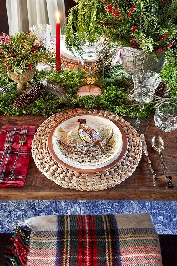 "<p>Who says holiday tables have to be decorated with holiday themes? Pinecones, fresh greens and found feathers play off the vintage china in a woodland motif. Set your scene off with natural rattan chargers and twig-inspired silverware.</p><p><a class=""link rapid-noclick-resp"" href=""https://www.amazon.com/Haussmann-Flatware-Handmade-Stainless-Setting/dp/B00BT76SDG/ref=sr_1_5?dchild=1&keywords=twig+silverware+set&qid=1603376651&sr=8-5&tag=syn-yahoo-20&ascsubtag=%5Bartid%7C10050.g.644%5Bsrc%7Cyahoo-us"" rel=""nofollow noopener"" target=""_blank"" data-ylk=""slk:SHOP SILVERWARE"">SHOP SILVERWARE</a></p>"