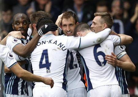Britain Football Soccer - West Bromwich Albion v Arsenal - Premier League - The Hawthorns - 18/3/17 West Bromwich Albion's Craig Dawson celebrates scoring their third goal with team mates  Reuters / Darren Staples Livepic