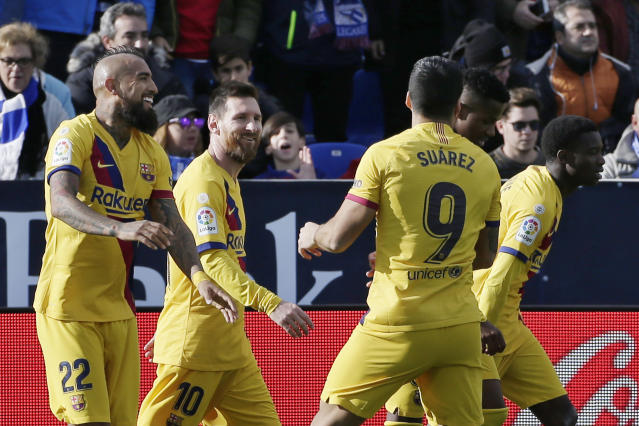 Barcelona's Arturo Vidal, left, celebrates with his teammates after scoring his side's second goal during a Spanish La Liga soccer match between Leganes and FC Barcelona at the Butarque stadium in Madrid, Spain, Saturday Nov. 23, 2019. (AP Photo/Paul White)