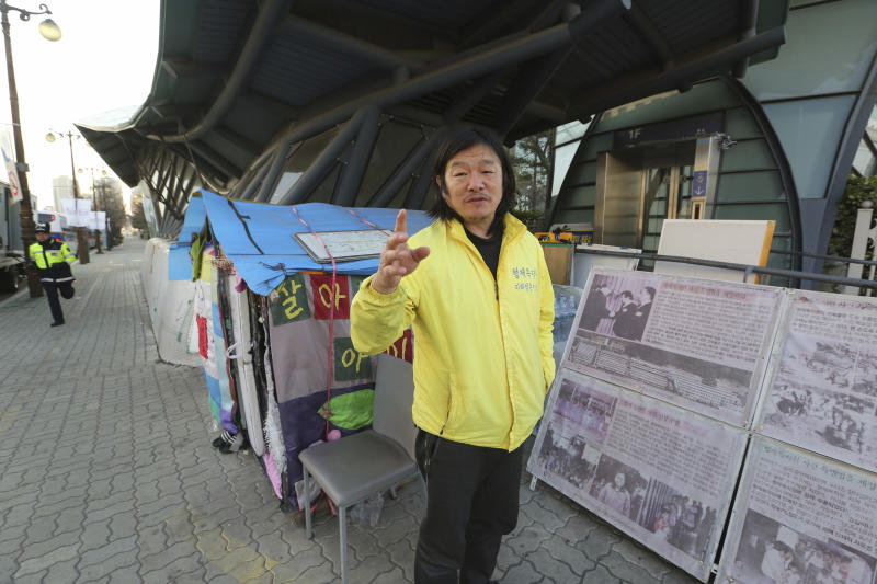 In this April 2, 2019, photo, Choi Seung-woo, a victim of Brothers Home, speaks during an interview in front of National Assembly in Seoul, South Korea. Choi and a small number of other Brothers Home inmates have been camping out in front of the National Assembly's gate for more than two years calling for lawmakers to pass a bill that would launch a full investigation into past human rights atrocities, including the Brothers Home incident. Notorious South Korean facility that kidnapped, abused and enslaved children and the disabled for a generation was also shipping children overseas for adoption as part of a massive profit-seeking enterprise. (AP Photo/Ahn Young-joon)