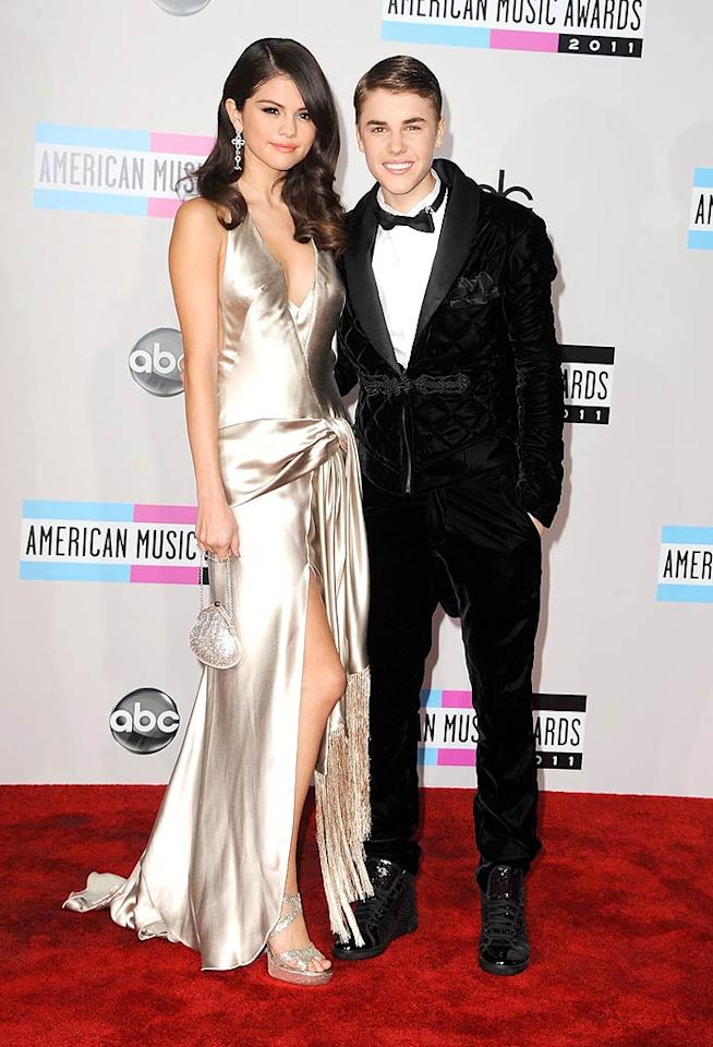 They might still be teenagers, but pop-singer couple Selena Gomez and Justin Bieber looked all grown up in their glamorous ensembles. Well, except for The Biebs' high-top sneakers, of course. (11/20/2011)
