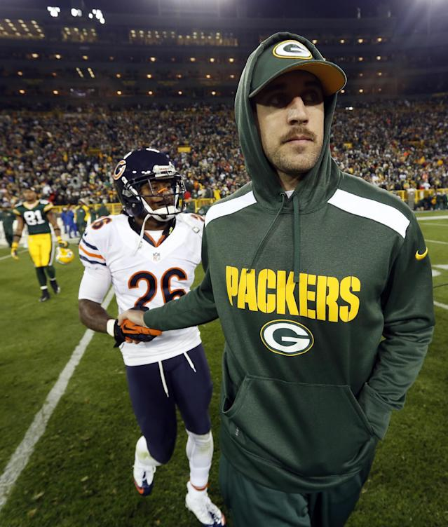 Green Bay Packers' Aaron Rodgers shakes hands with Chicago Bears' Tim Jennings (26) after an NFL football game Monday, Nov. 4, 2013, in Green Bay, Wis. Rodgers was injured in the first half of the game and did not return. The Bears won 27-20. (AP Photo/Mike Roemer)