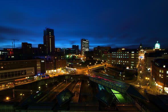 Birmingham skyline with light trails of cars moving. Overlooking The Orion building, Alpha Tower and New Street Train Station