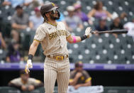 San Diego Padres' Fernando Tatis Jr. drops his bat after hitting a solo home run in the third inning of a baseball game Wednesday, June 16, 2021, in Denver. (AP Photo/David Zalubowski)