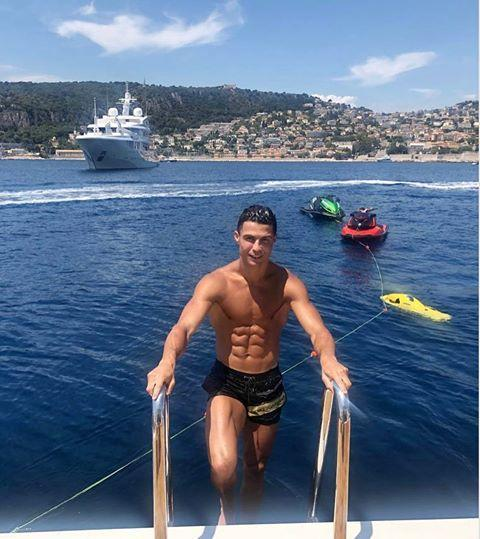 """<p>Ronaldo captioned this June 2019 photo with the cheeky phrase, """"enjoy the view."""" So, yes, he knows exactly what he is doing here.</p><p><a href=""""https://www.instagram.com/p/By8AFW2AzmT/"""" rel=""""nofollow noopener"""" target=""""_blank"""" data-ylk=""""slk:See the original post on Instagram"""" class=""""link rapid-noclick-resp"""">See the original post on Instagram</a></p>"""